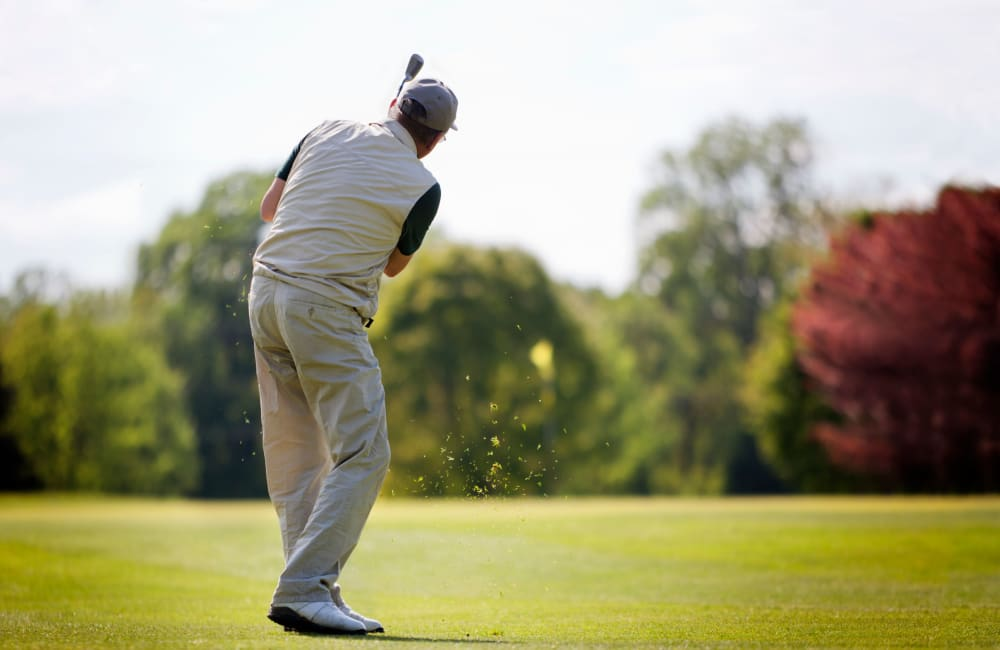 Resident playing golf at a golf course in Atwater, California near Castle Vista Senior Duplex Community