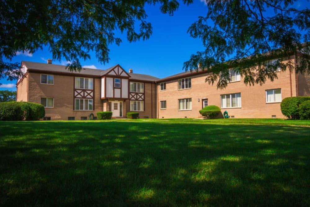 Open grass areas around President Madison Apartments in Madison Heights, Michigan