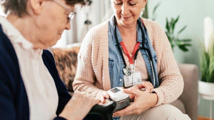 Caregiver checking senior
