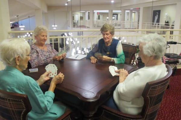 Residents playing a game together at Fairview Estates Gracious Retirement Living in Hopkinton, Massachusetts