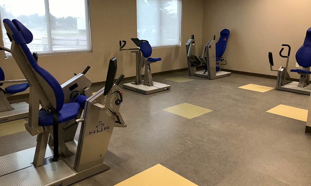 Assisted walking machines in the gym at Quail Park at Browns Point in Tacoma, Washington