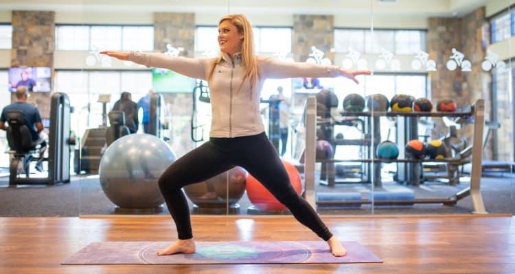 Resident doing yoga at the gym at San Milan in Phoenix, Arizona