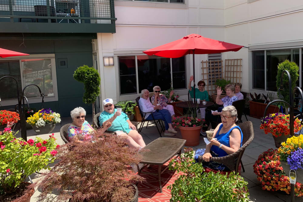 senior residents enjoying the weather in the courtyard