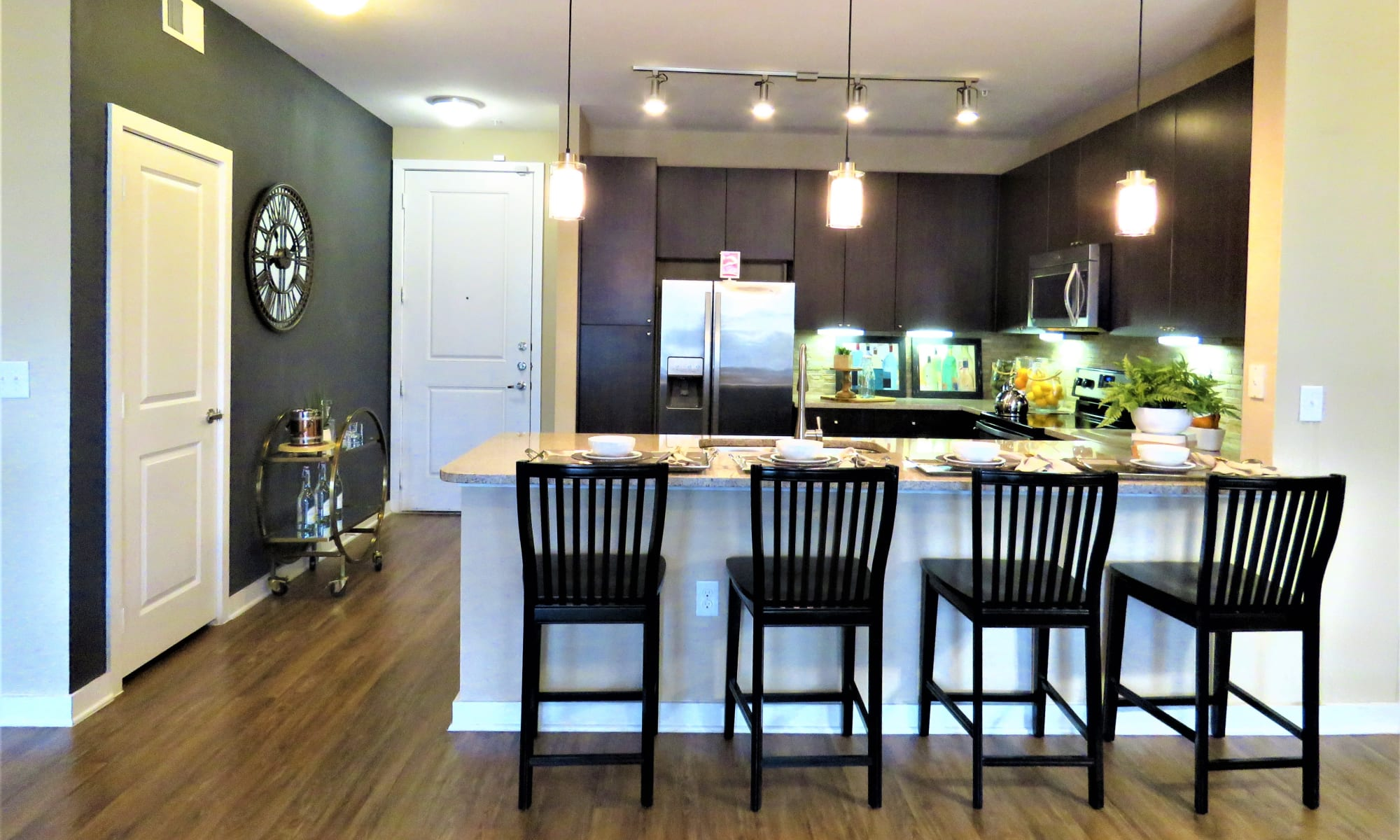 View of model apartment home's kitchen from the breakfast bar at The Abbey at Spring Town Center