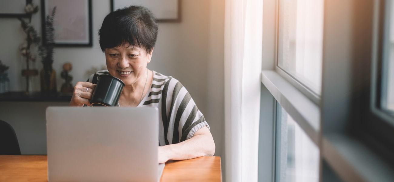 A resident watching a Merrill Gardens webinar.