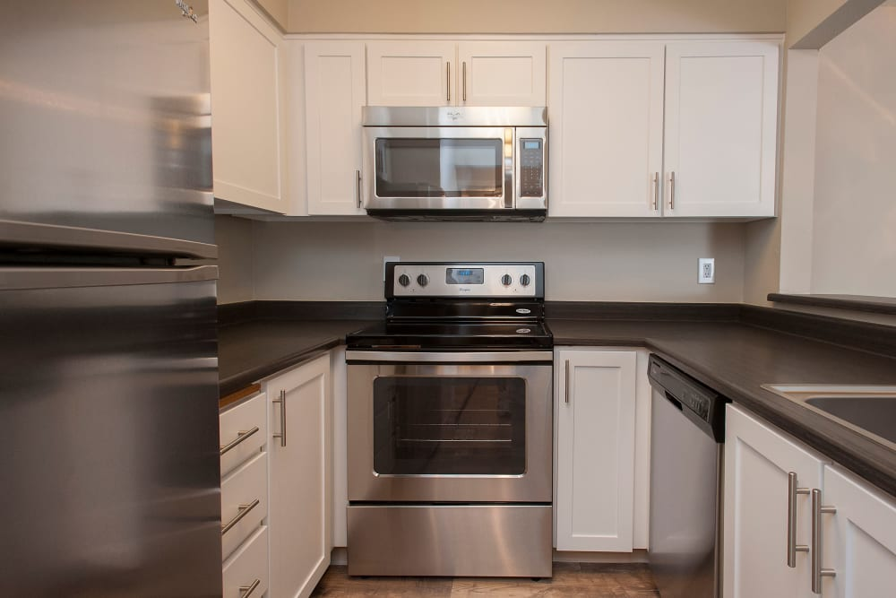 Apartment kitchen with stainless-steel appliances at Waterhouse Place in Beaverton, Oregon
