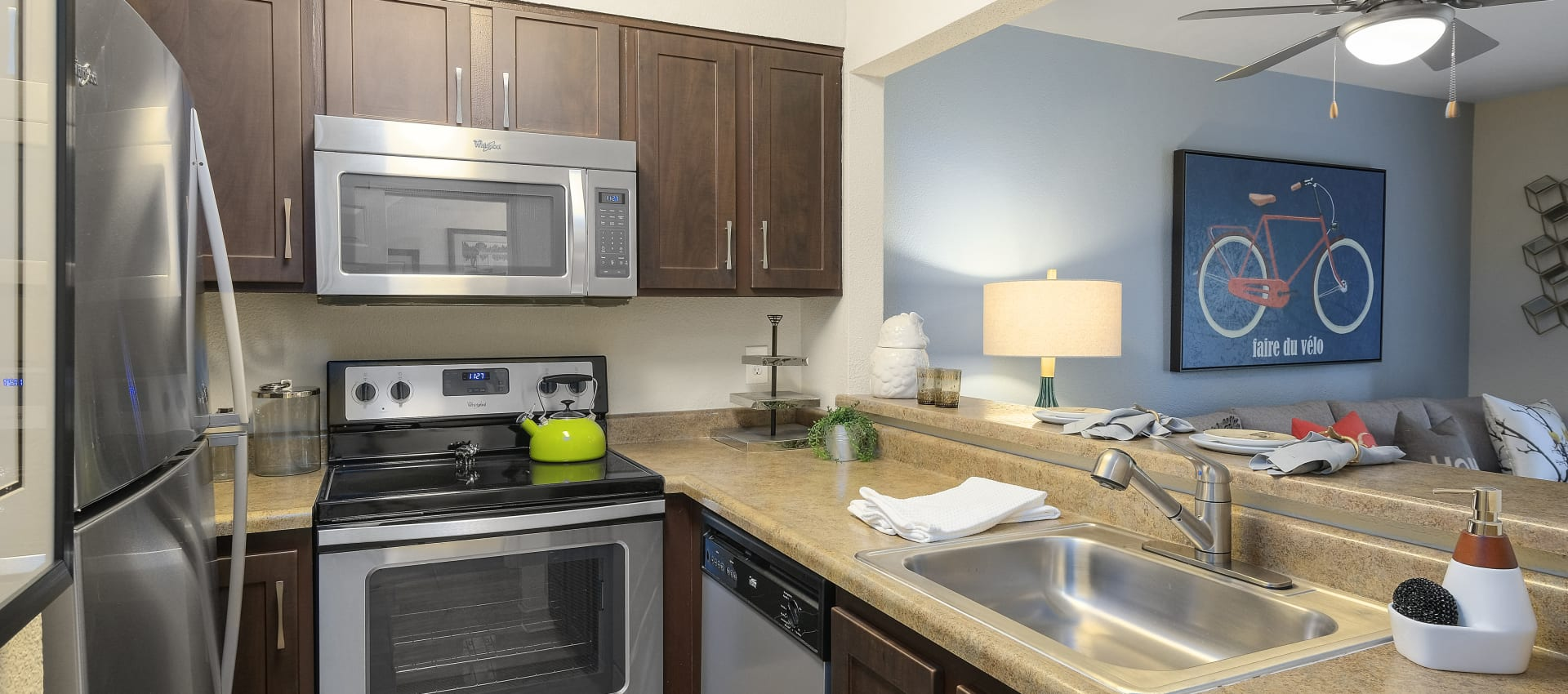 Kitchen With Stainless Appliances at Waterhouse Place in Beaverton, OR