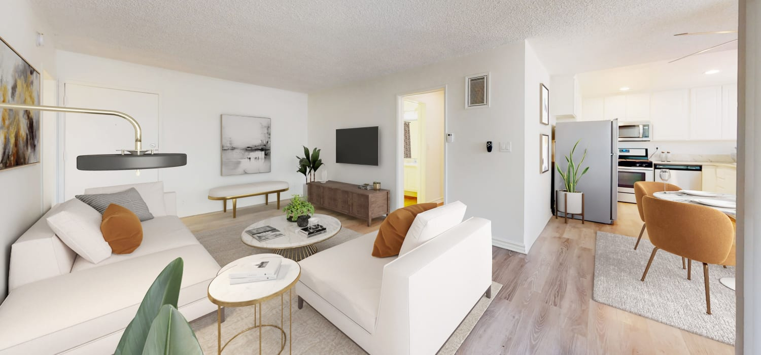 Living room and view of the dining room in a two-bedroom apartment at Sunset Barrington Gardens in Los Angeles, California