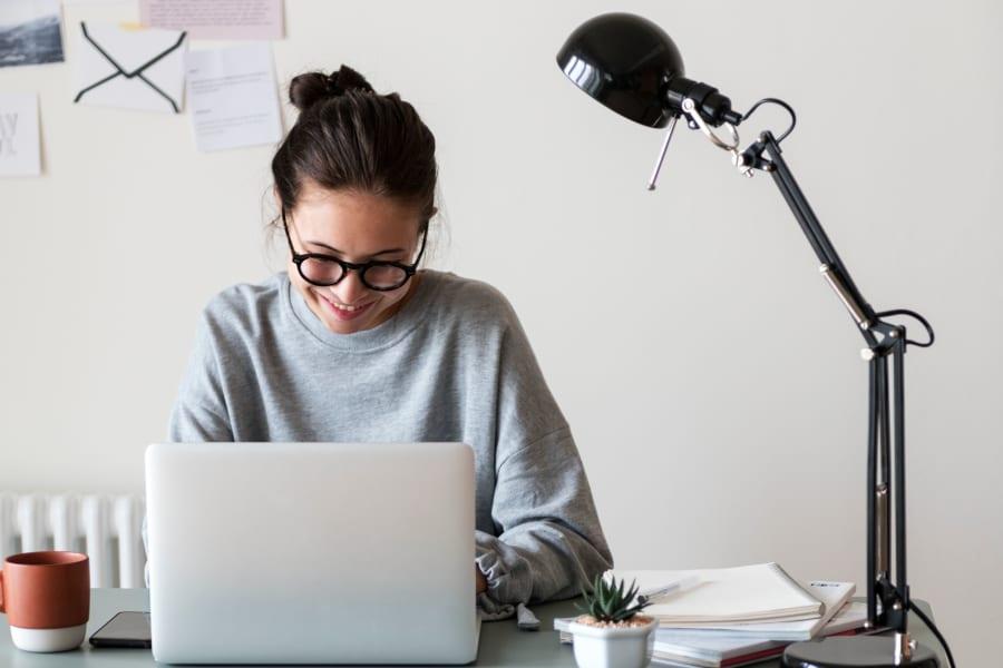 Resident student doing some homework on her laptop at Sofi Fremont in Fremont, California
