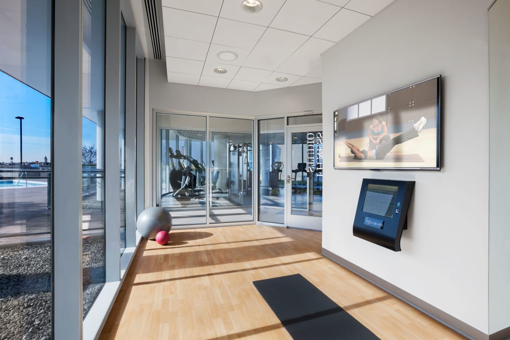 Quiet yoga studio with a flat screen TV at The Residences at NEWCITY in Chicago, Illinois