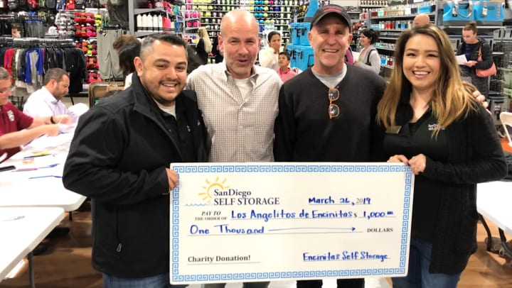 Encinitas Self Storage presenting donation to Los Angelitos de Encinitas
