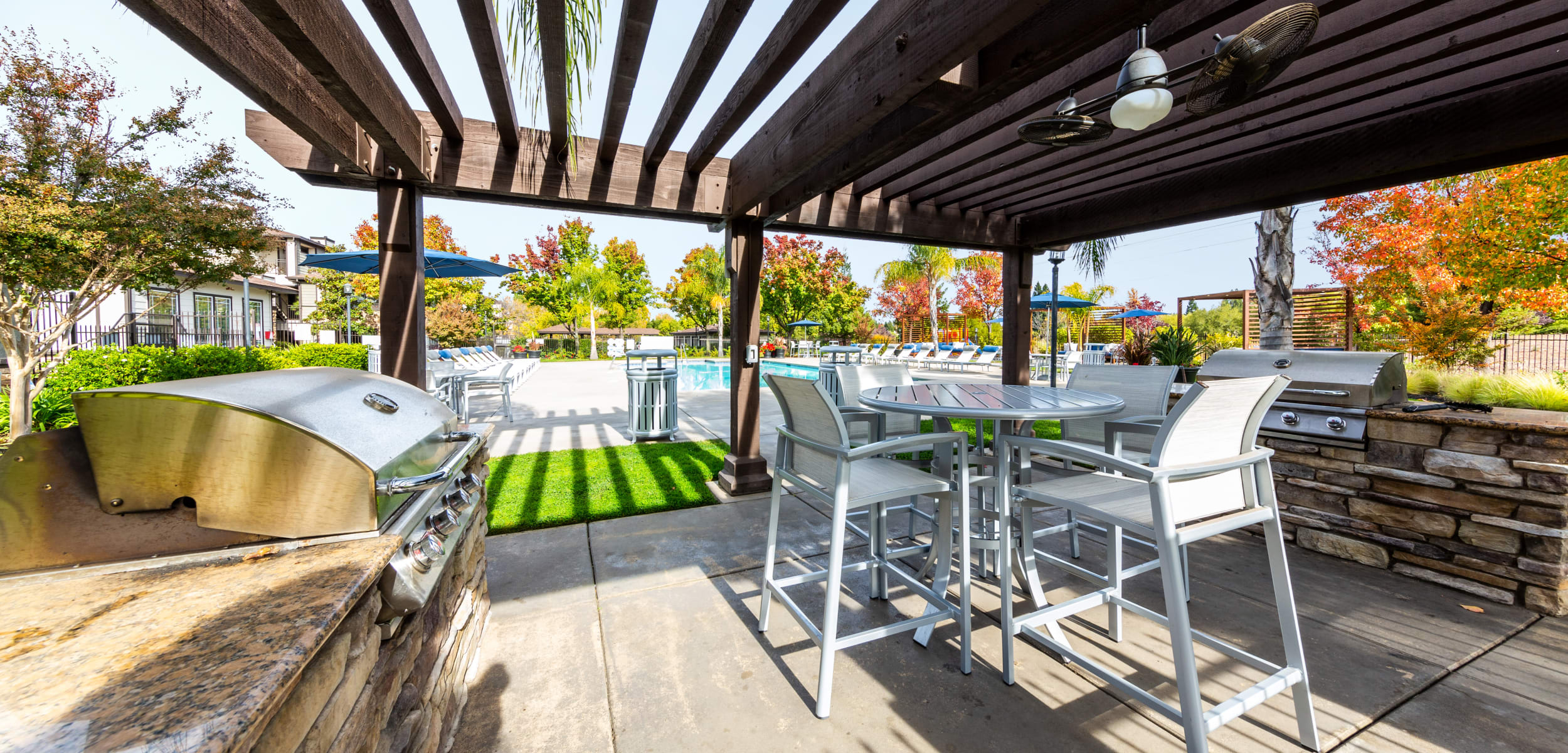 Outdoor covered poolside BBQ and dining area at The Fairmont at Willow Creek in Folsom, California