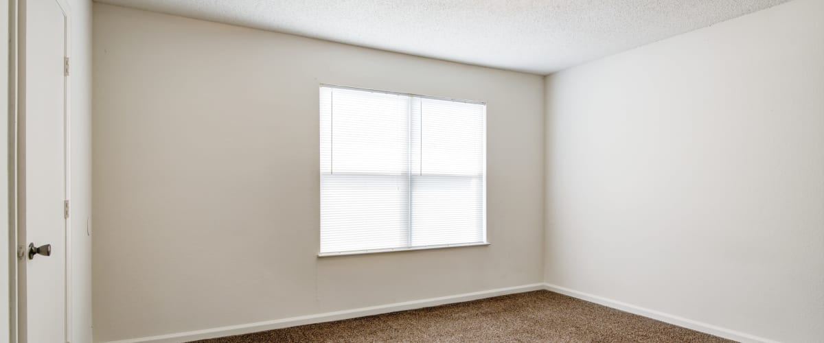 A bedroom with a large window at Cedar Ridge in La Vergne, Tennessee