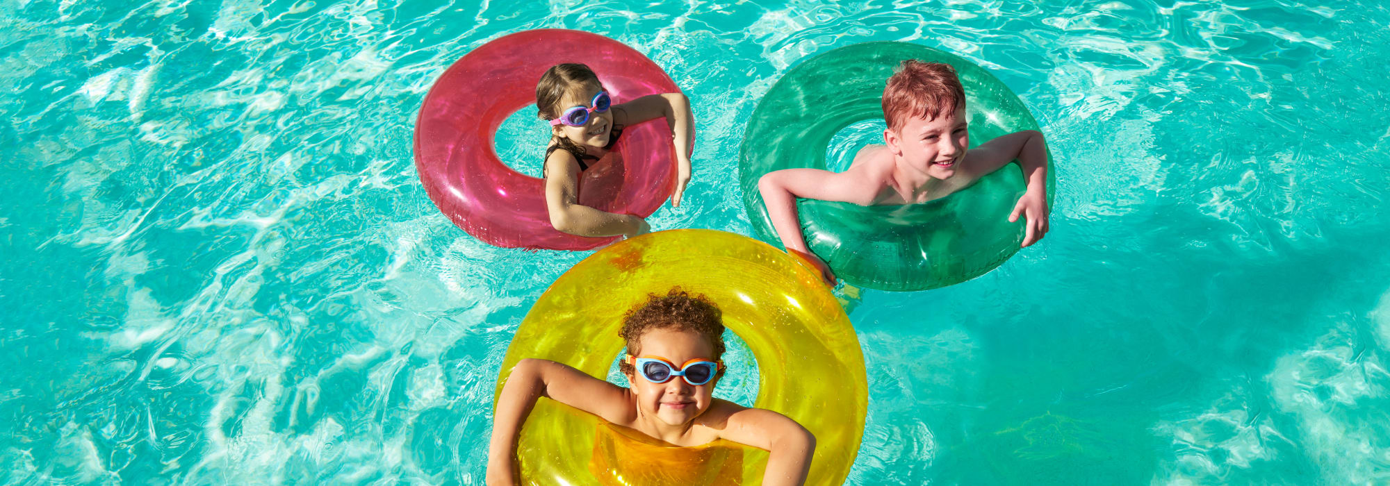 Children playing in pool at BB Living at Eastmark in Mesa, Arizona