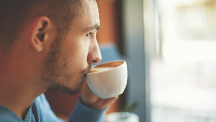 Man drinking pumpkin spice latte near Redstone at SanTan Village