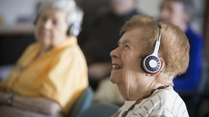 Woman wearing headphones to hear activities better.