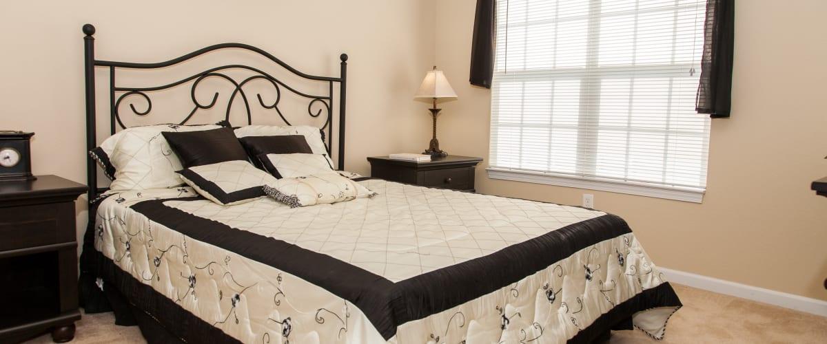 A comfortable bedroom at O'Fallon Lakes in O'Fallon, Missouri