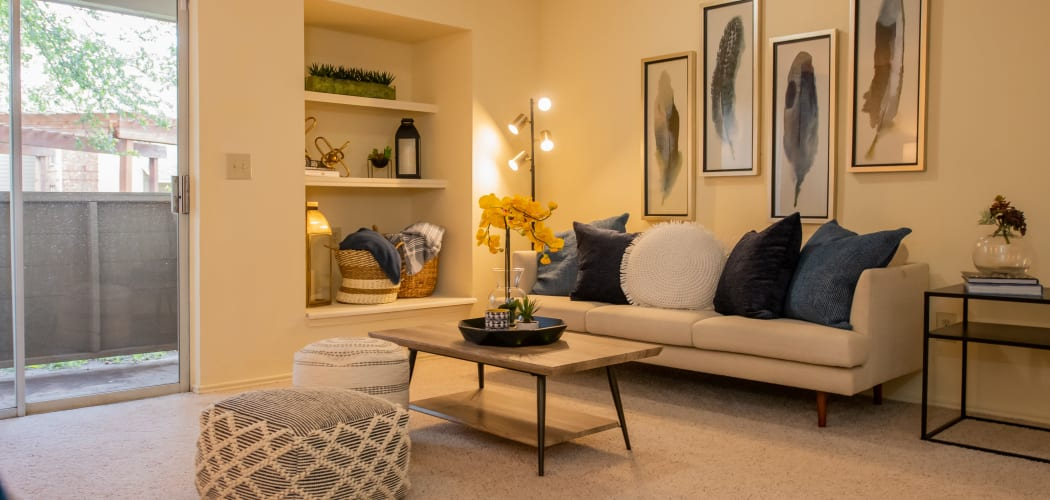 Spacious living room with built-in shelves at Newport Apartments in Amarillo, Texas