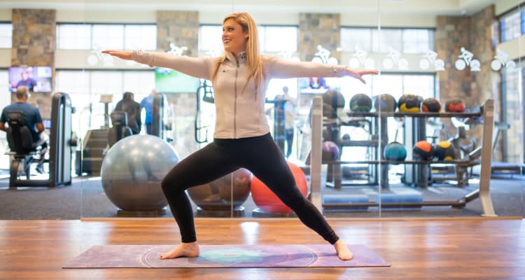 Resident doing some yoga in the fitness center at Avant at Fashion Center in Chandler, Arizona