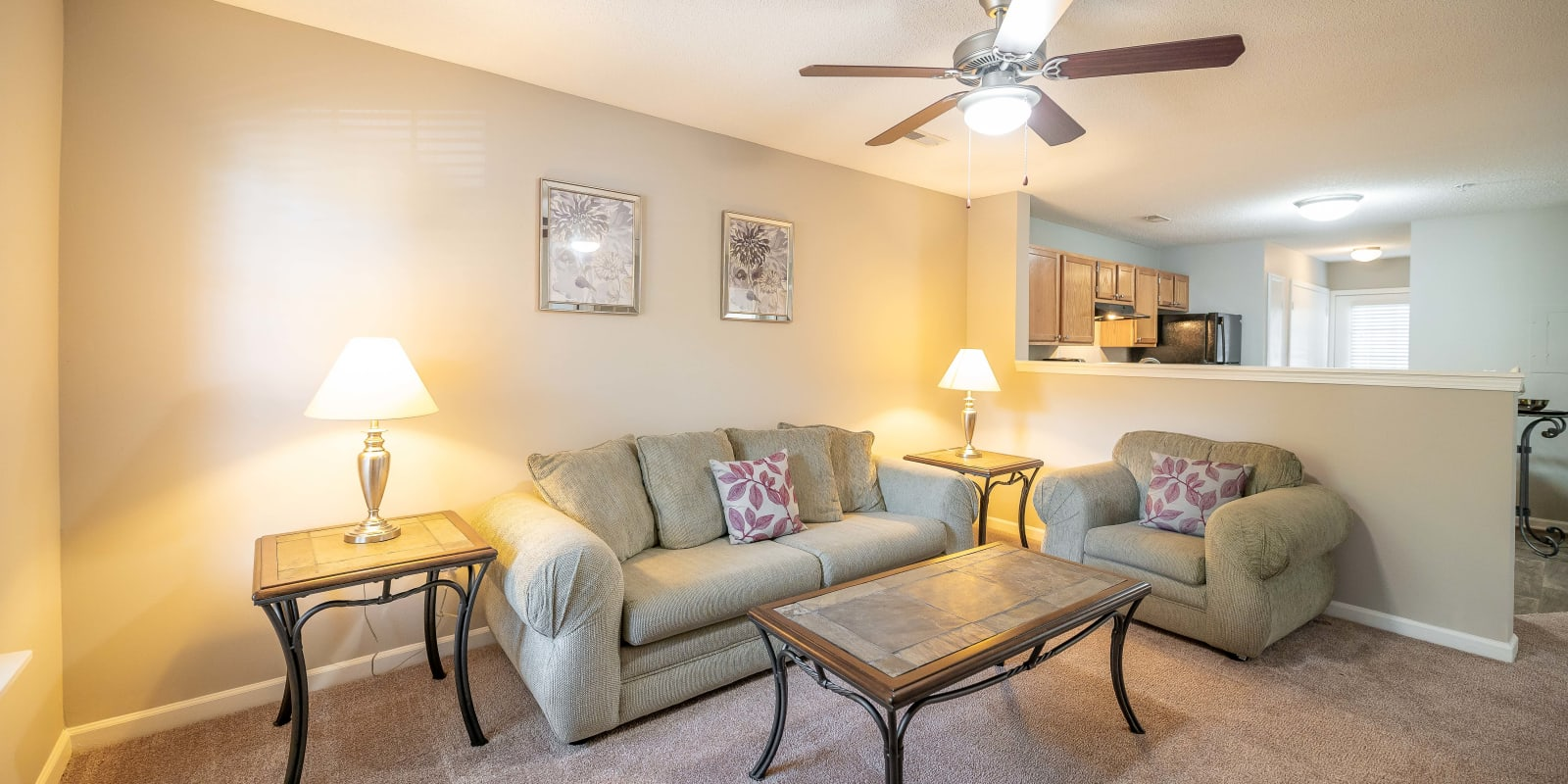 Spacious living room with a ceiling fan at The Village at Brierfield Apartment Homes in Charlotte, North Carolina