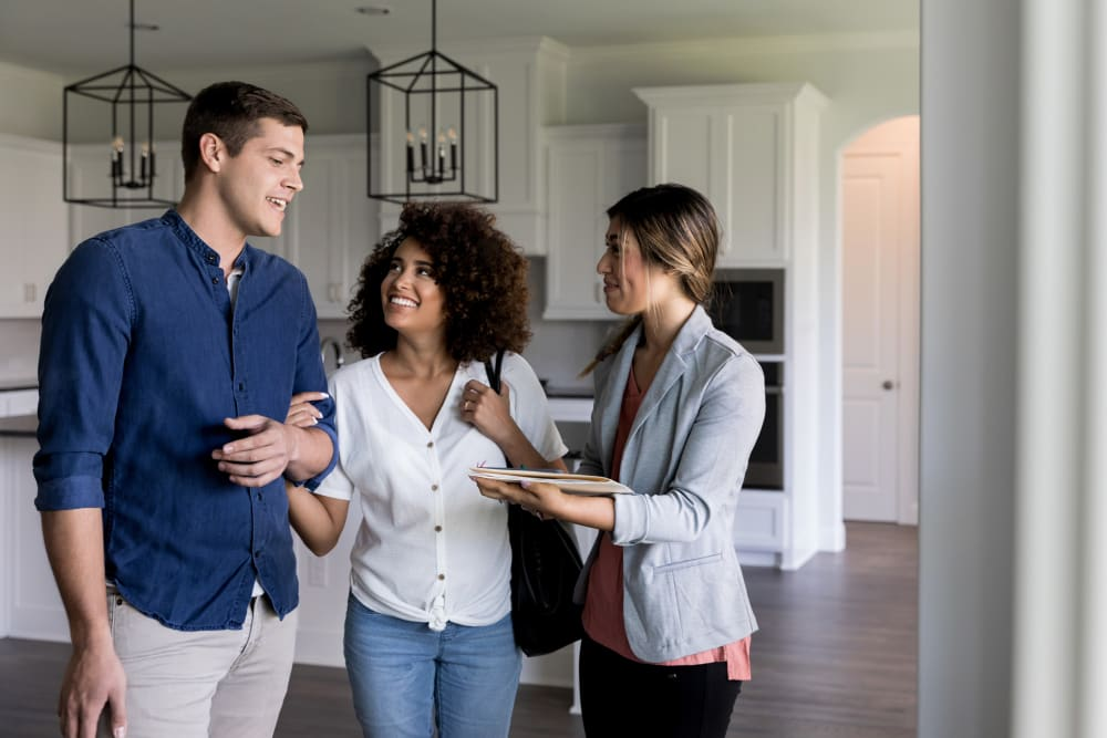 Couple talking to a property manager about a home with Morgan Properties in King of Prussia, Pennsylvania