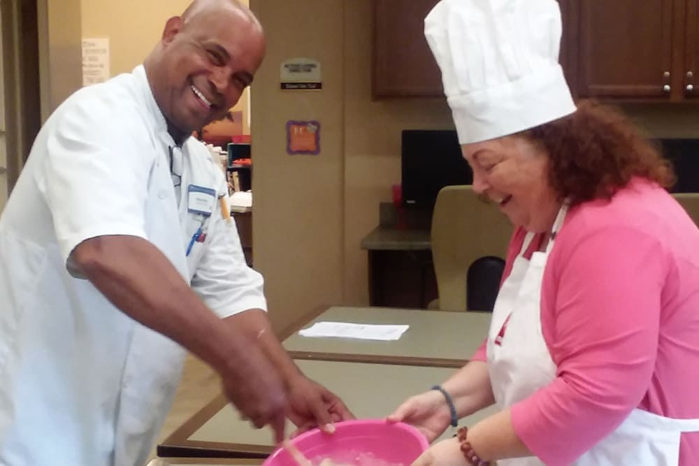 Executive Chef making cookies with residents at Merrill Gardens at Huntington Beach