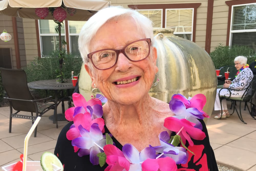 Resident enjoying the annual Luau party at Merrill Gardens at Gilroy