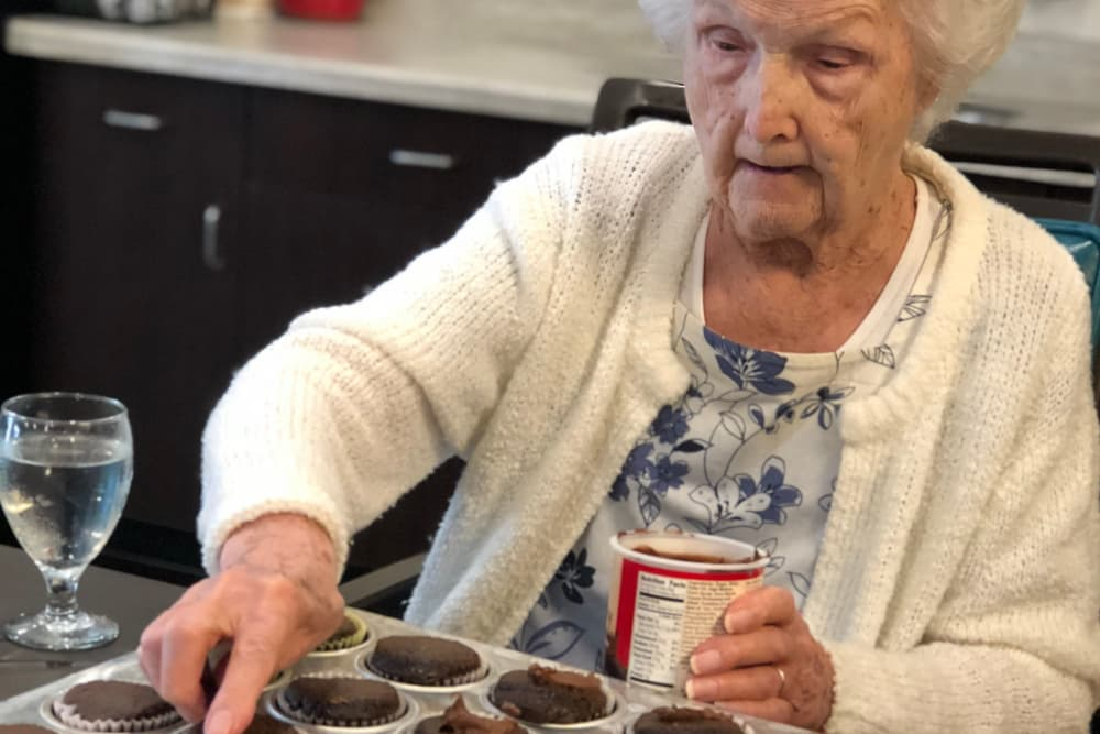 A resident frosting cupcakes at Aspen Place Health Campus in Greensburg, Indiana