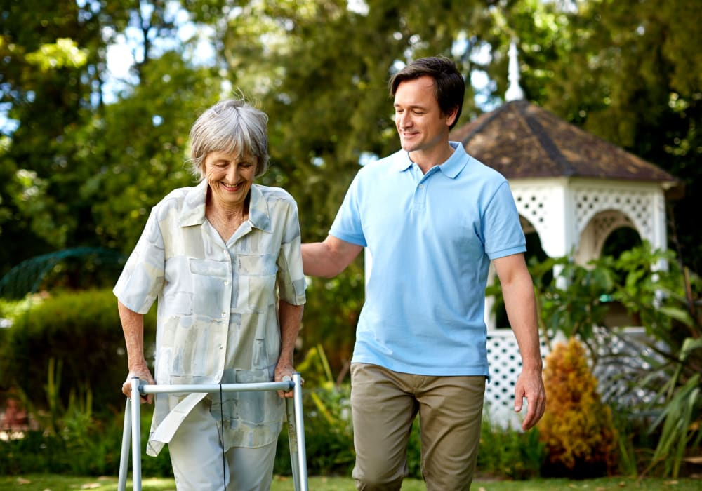 Resident and son walking at Golden Pond Retirement Community in Sacramento, California