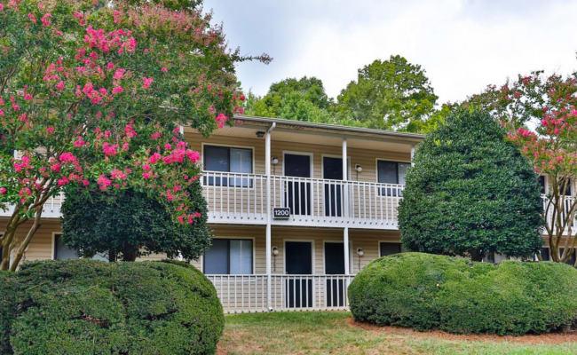 A beautifully manicured landscape at Huntersville Apartment Homes in Huntersville, North Carolina