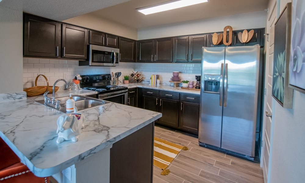 Bright kitchen with espresso cabinets and white countertops at Cottages at Crestview in Wichita, Kansas