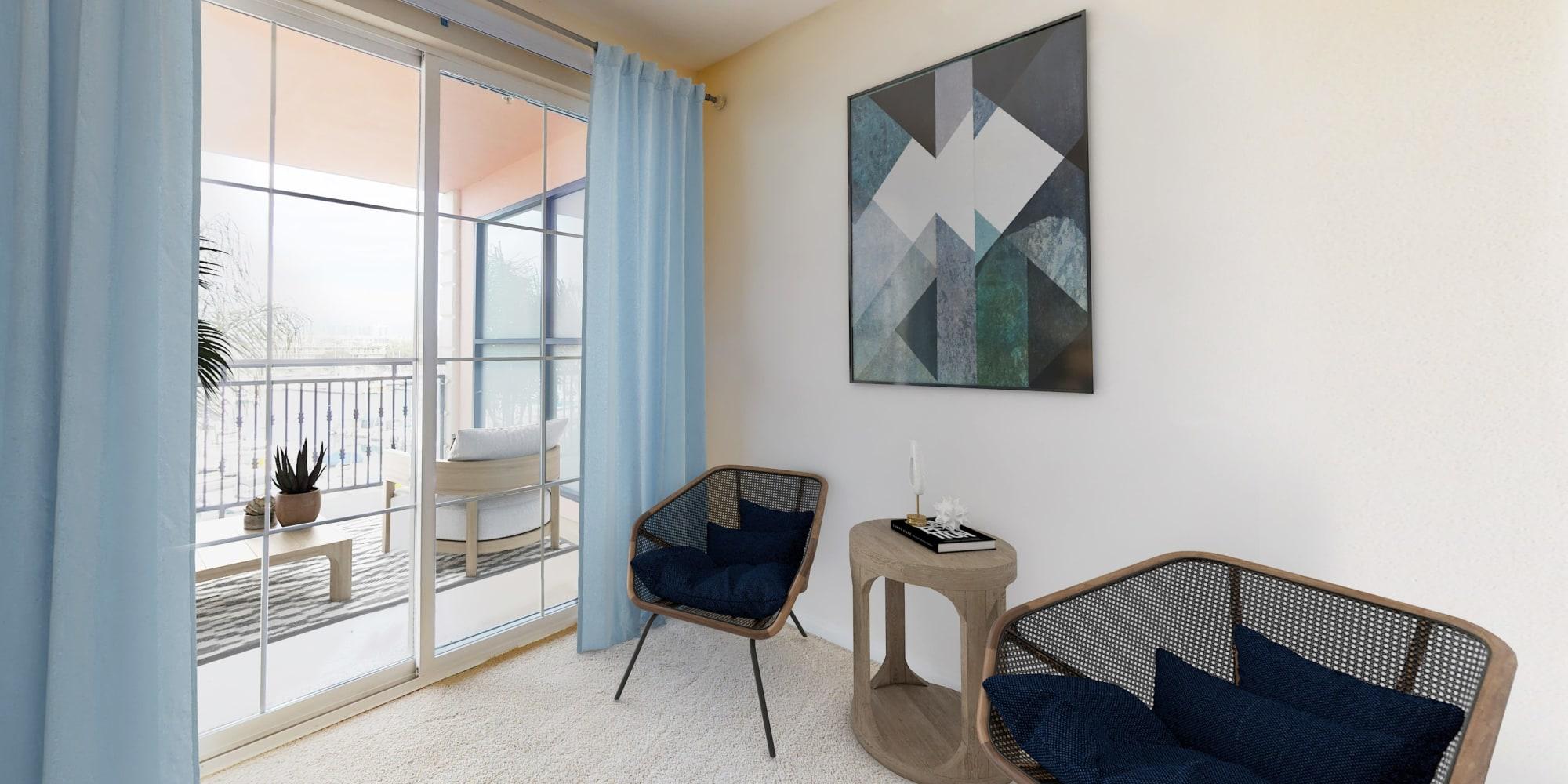 Sitting area inside large bedroom and balcony overlooking the marina at The Villa at Marina Harbor in Marina del Rey, California