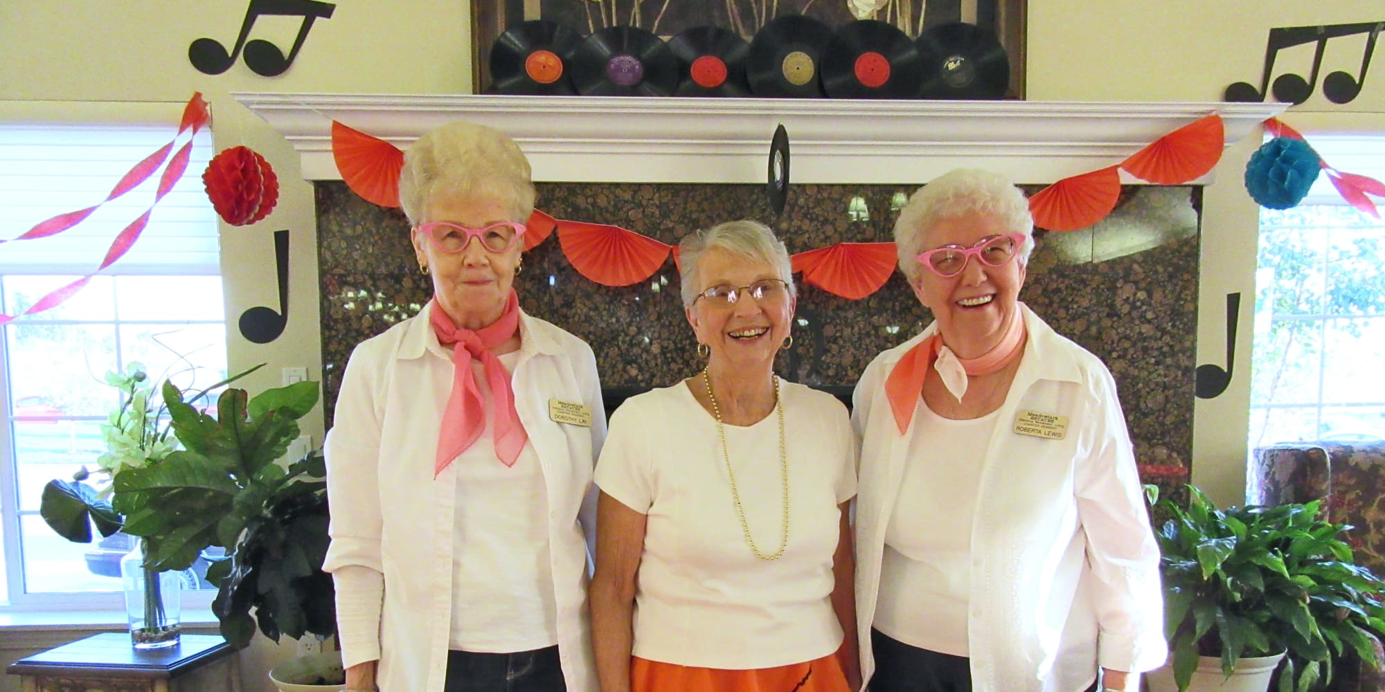 Three residents dressed up for a themed day at Meadowlark Estates Gracious Retirement Living in Lawrence, Kansas