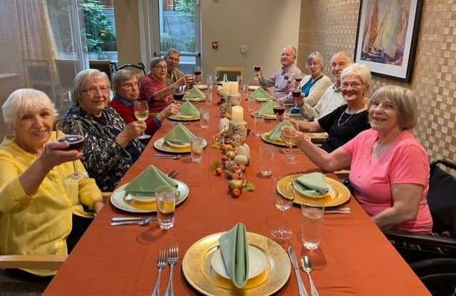 Ballard residents gather around the table to celebrate the community's September birthdays!