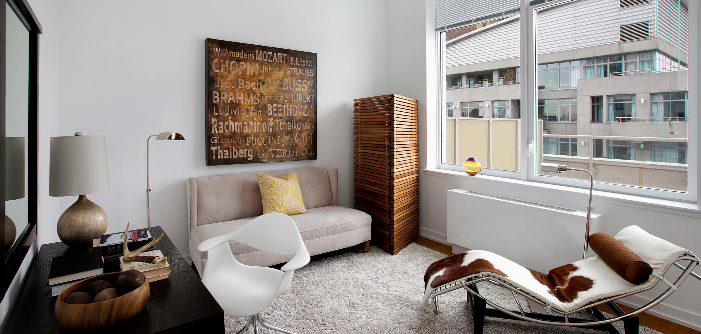 Modern living room with a large window at The Larstrand in New York, New York