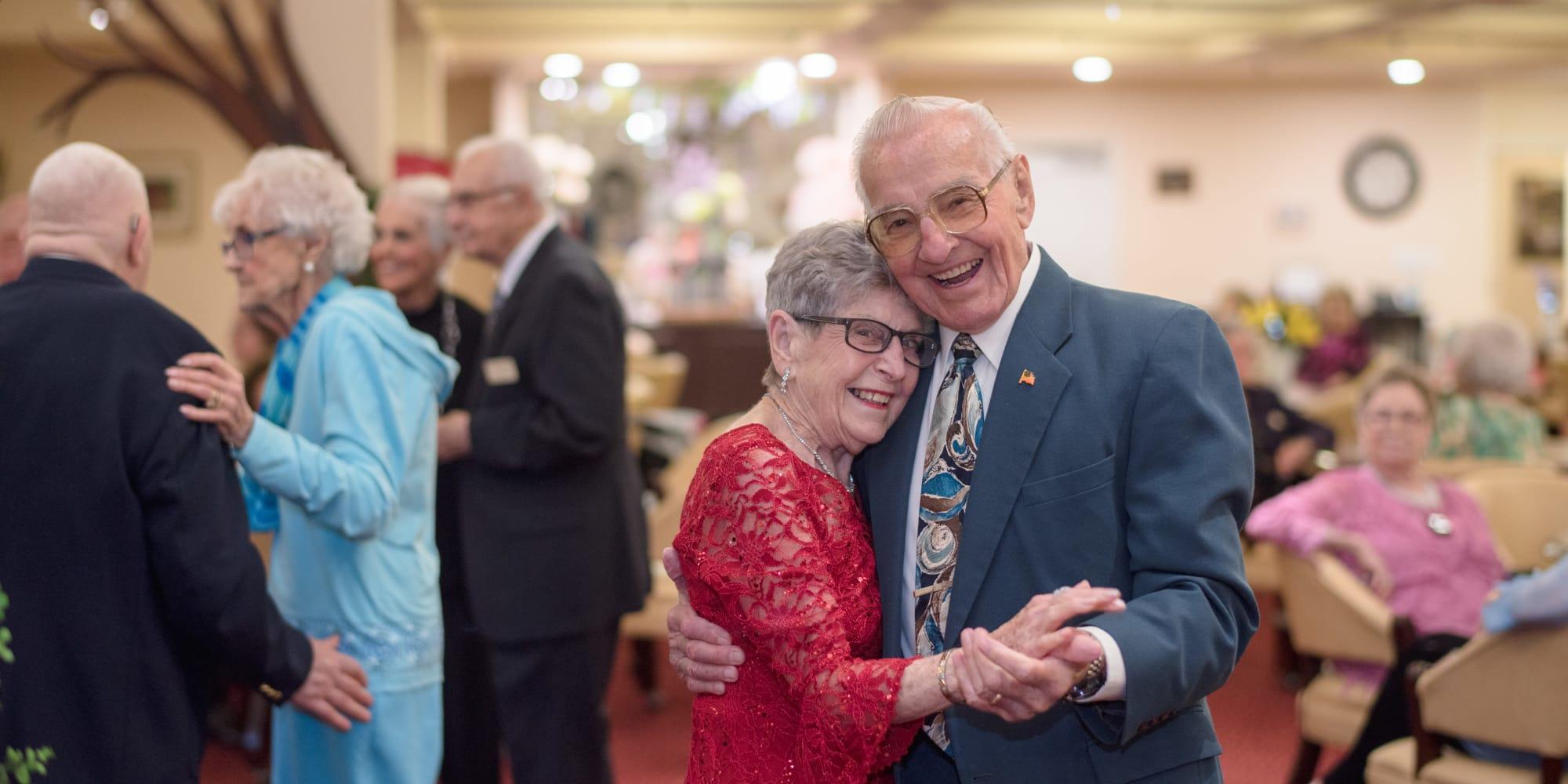 A happy couple dancing at Julian Estates Gracious Retirement Living in Puyallup, Washington