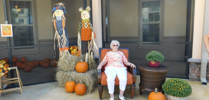 resident taking a photo with pumpkins