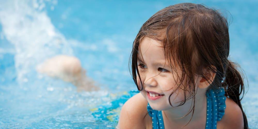 Girl having fun in the pool at Garland Square in Norman, Oklahoma