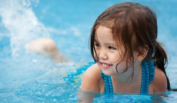A happy child in a a pool at Park Ridge Apartments in Jackson, Tennessee