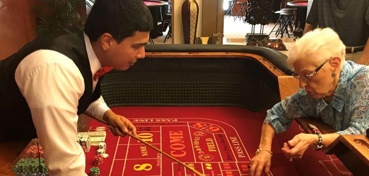 senior man enjoying casino night