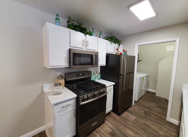Kitchen with black appliances in a model apartment at Alterra Apartments in Las Vegas, Nevada