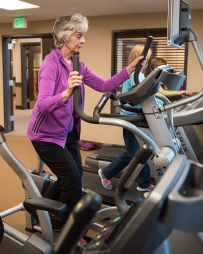 Resident working out at fitness center at The Springs at Tanasbourne in Hillsboro, Oregon.