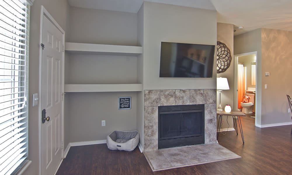 Spacious living room with fireplace at Perry's Crossing Apartments in Perrysburg, Ohio