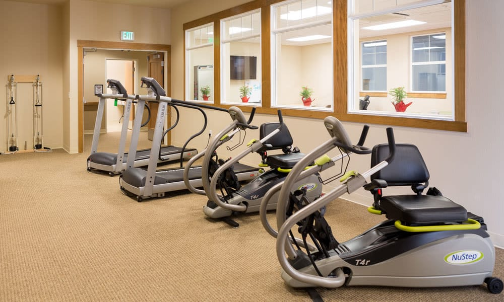 Treadmills and rowers in the gym at Quail Park at Browns Point in Tacoma, Washington