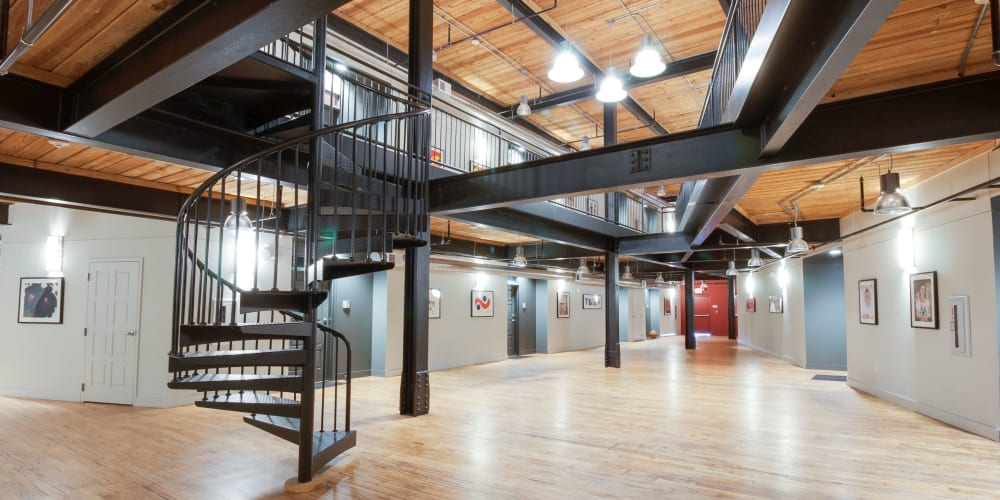 Foyer with a spiral staircase at The Gallery Lofts in Winston Salem, North Carolina