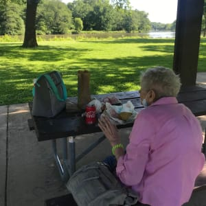 Resident Marilyn having a picnic at Edencrest at Green Meadows in Johnston, Iowa.