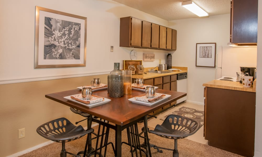 Bright dining room and kitchen at Fox Run Apartments in Wichita, Kansas