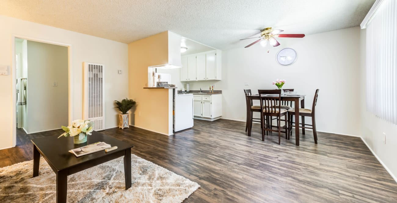 Spacious living and dining area with wood flooring at Vista Pointe I in Studio City, California