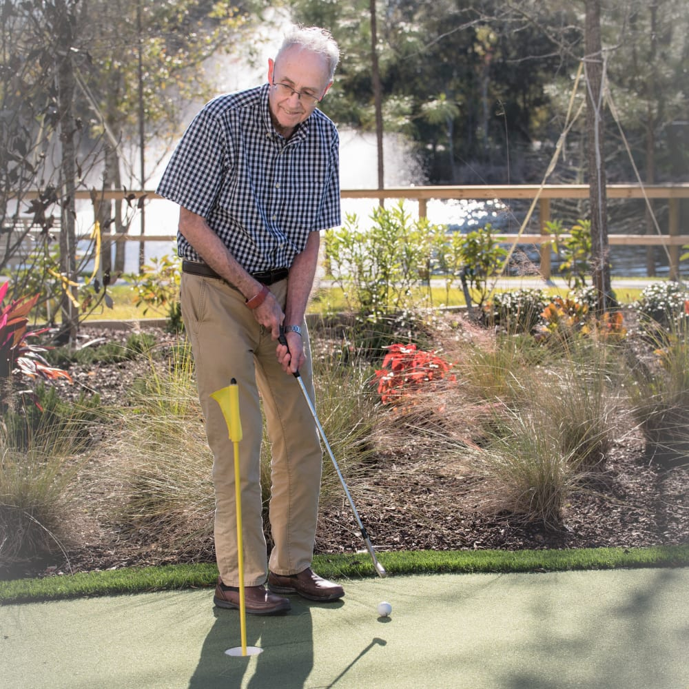 Resident golfing at Inspired Living in Sugar Land, Texas