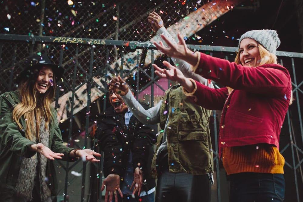 Friends throwing confetti at HERE Champaign in Champaign, Illinois